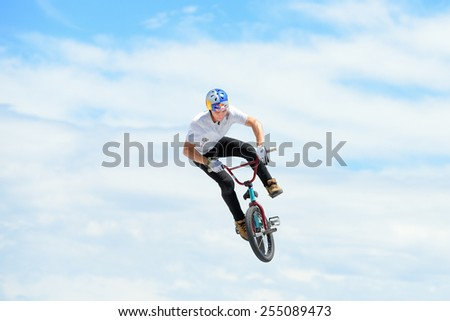 BARCELONA - JUNE 28: A professional rider at the MTB (Mountain Biking) competition on the Dirt Track at LKXA Extreme Sports Barcelona Games on June 28, 2014 in Barcelona, Spain. - stock photo