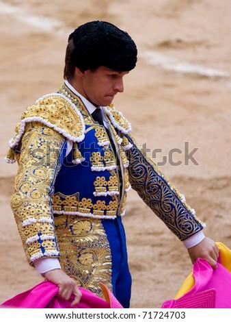 "BARCELONA - JUNE 6: ""Corrida"" (bull fight) of bulls, typical Spanish tradition where a torero kills a bull. In the picture, ""El Juli"". June 6, 2010 in Barcelona (Spain). - stock photo"