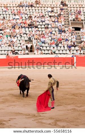"""BARCELONA - JUNE 6: """"Corrida"""" (bullfight) of bulls, typical Spanish tradition where a torero (bullfighter) kills a bull. In the picture, """"Finito de Cordoba"""". June 6, 2010 in Barcelona (Spain). - stock photo"""