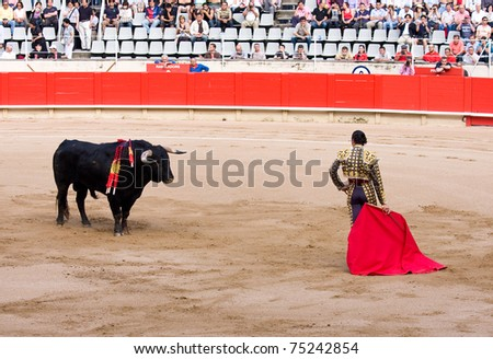 BARCELONA - JUNE 6: Finito de Cordoba in action during a bullfighting, typical Spanish tradition where a bullfighter kills a bull. June 6, 2010 in Barcelona (Spain). - stock photo