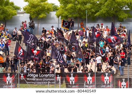 BARCELONA - JUNE 4: Jorge Lorenzo's supporters during Qualifying Session of MotoGP Grand Prix of Catalunya, on June 4, 2011 in Barcelona, Spain. - stock photo