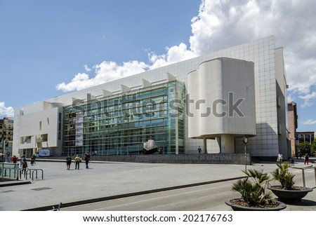 """BARCELONA - JUNE 26, 2014: MACBA """"Museo De Arte Contemporaneo"""" in Barcelona, Spain. Build in 1995 by Richard Meier, set in the square of angels, in district of Raval, modern art exhibitions. - stock photo"""