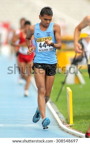 BARCELONA - JUNE, 13: Neeraj Neeraj of India during 10000 metres race walk event of of the 20th World Junior Athletics Championships at the Olympic Stadium on July 13, 2012 in Barcelona, Spain - stock photo