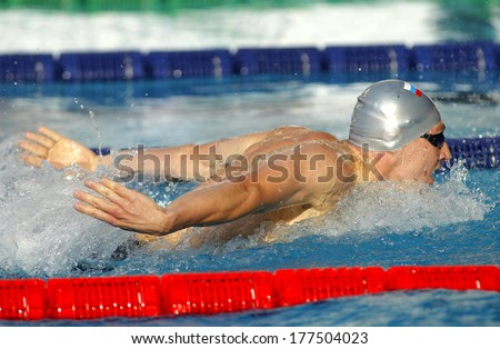 BARCELONA - JUNE, 11: Russian swimmer Nikolay Skvortsov swimming Butterfly during the Mare Nostrum meeting in Barcelona's Sant Andreu club, June 11, 2013 in Barcelona, Spain - stock photo