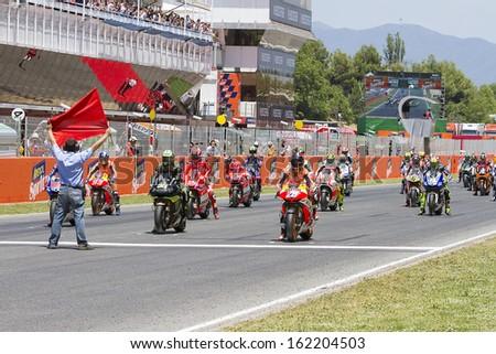 BARCELONA - JUNE 16: Some riders racing at MotoGP Grand Prix of Catalunya, on June 16, 2013 in Montmelo, Barcelona, Spain. - stock photo