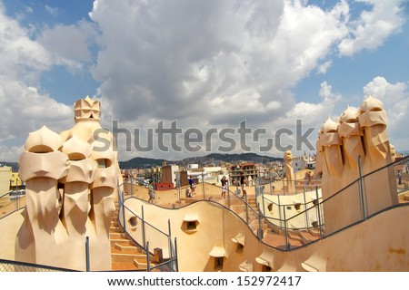 BARCELONA - JUNE 5: The rooftop of Casa Mila / La Pedrera with its famous chimneys from architect Antonio Gaudi on June 5, 2008 in Barcelona, Spain - stock photo