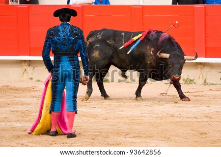 BARCELONA - JUNE 6: unidentified Bullfighter in action during a corrida de toros or bullfight, typical Spanish tradition where a torero or bullfighter kills a bull on June 6, 2010 in Barcelona, Spain. - stock photo