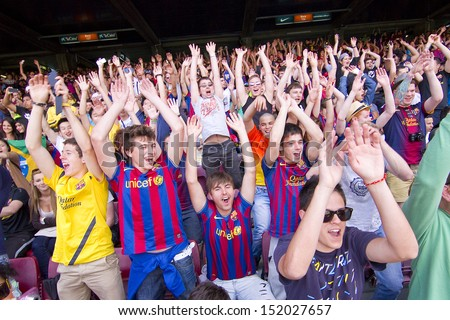 BARCELONA - JUNE 3: Unidentified supporters during Brazilian footballer Neymar Da Silva Santos Junior official presentation as new FC Barcelona player, on June 3, 2013, in Barcelona, Spain. - stock photo