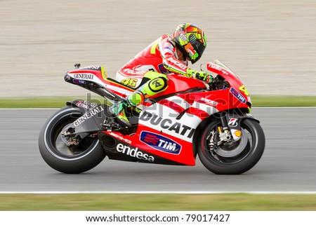 BARCELONA - JUNE 5: Valentino Rossi (Ducati) racing at the race of MotoGP Grand Prix of Catalunya, on June 5, 2011 in Barcelona, Spain. - stock photo