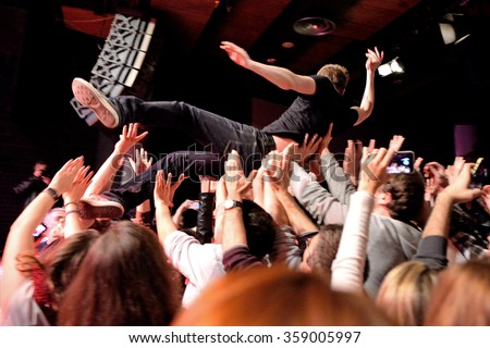 BARCELONA - MAR 18: The singer of The Subways (rock band) performs with the crowd at Bikini stage on March 18, 2015 in Barcelona, Spain. - stock photo