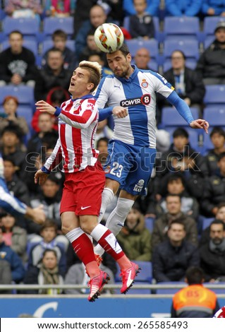 BARCELONA - MARCH, 14: Antoine Griezmann of Atletico Madrid Anaitz Arbilla of Espanyol headbutt during a Spanish League match at the Estadi Cornella on March 14, 2015 in Barcelona, Spain - stock photo