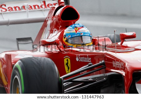 BARCELONA - MARCH 1: Fernando Alonso of Ferrari F1 team during Formula One Test Days at Catalunya circuit on March 1, 2013 in Barcelona, Spain. - stock photo
