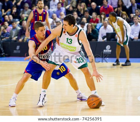 BARCELONA - MARCH 24: Jaka Lakovic (L) and Dimitris Diamantidis (R) in action during the Euroleague basketball match between Barcelona and Panathinaikos, 71-75, on March 24, 2011 in Barcelona, Spain. - stock photo