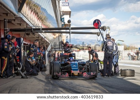 BARCELONA - MARCH 3: Max Verstappen of Toro Rosso F1 Team makes a pit stop at Formula One Test Days at Catalunya circuit on March 3, 2016 in Barcelona, Spain. - stock photo