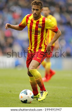 BARCELONA - MARCH, 29: Neymar da Silva of FC Barcelona in action during a Spanish League match against RCD Espanyol at the Estadi Cornella on March 29, 2014 in Barcelona, Spain - stock photo