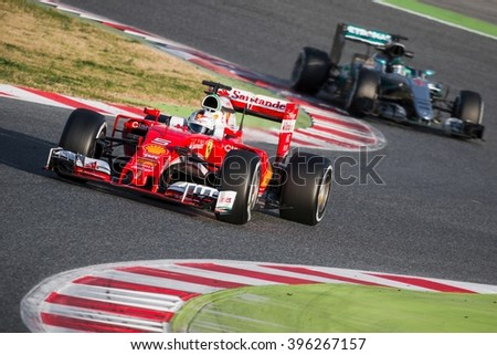 BARCELONA - MARCH 2: Sebastian Vettel of Ferrari F1 Team leads Nico Rosberg of Mercedes AMG F1 Team at Formula One Test Days at Catalunya circuit on March 2, 2016 in Barcelona, Spain. - stock photo