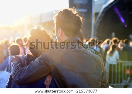 BARCELONA - MAY 30: A couple of the audience watch a concert together at Heineken Primavera Sound 2014 Festival (PS14) on May 30, 2014 in Barcelona, Spain. - stock photo