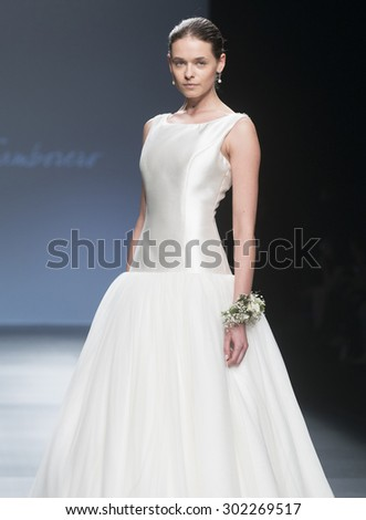 BARCELONA - MAY 06: a model walks on the Cristina Tamborero bridal collection 2016 catwalk during the Barcelona Bridal Week runway on May 06, 2015 in Barcelona, Spain.   - stock photo