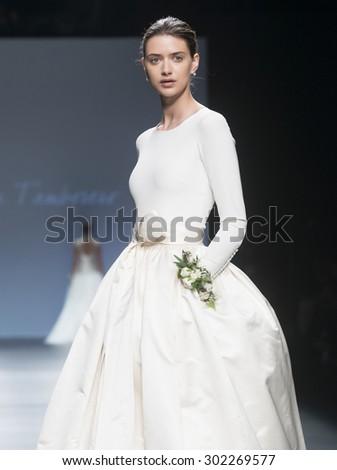 BARCELONA - MAY 06: a model walks on the Cristina Tamborero bridal collection 2016 catwalk during the Barcelona Bridal Week runway on May 06, 2015 in Barcelona, Spain.   - stock photo
