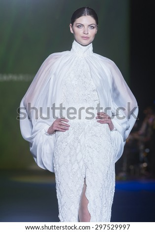 BARCELONA - MAY 07: a model walks on the Isabel Zapardiez bridal collection 2016 catwalk during the Barcelona Bridal Week runway on May 07, 2015 in Barcelona, Spain.  - stock photo