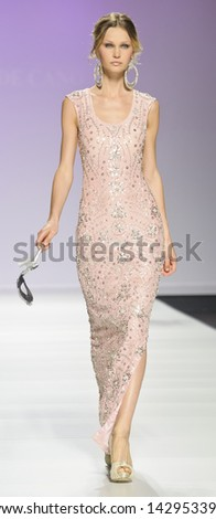 BARCELONA - MAY 02: A model walks on the Matilde Cano catwalk during the Barcelona Bridal Week runway on May 02, 2013 in Barcelona, Spain. - stock photo