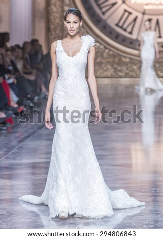 BARCELONA - MAY 08: a model walks on the Pronovias bridal collection 2016 catwalk during the Barcelona Bridal Week runway on May 08, 2015 in Barcelona, Spain.  - stock photo