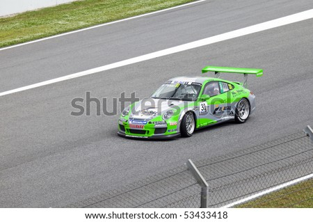 "BARCELONA- MAY 9: Abdulaziz Al Faisal of Al Faisal Lechner Racing in action during Porsche Mobil 1 Supercup at autodrome ""Catalunya Montmello"" on May 9, 2010 in Barcelona. Al Faisal  finished 15 - stock photo"