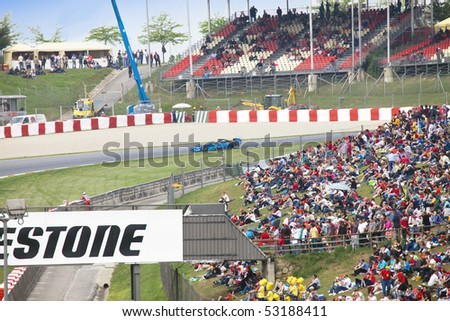 BARCELONA - MAY 9: Automobiles of stage are fleet GP2 on line and tribunes, full fans on may 9, 2010  in Barcelona, Spain - stock photo