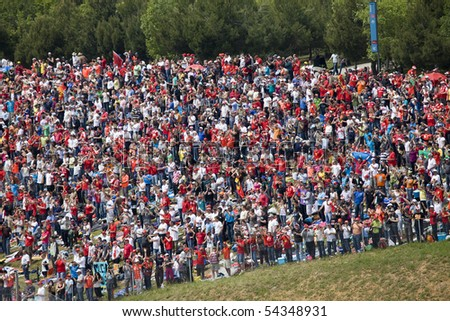 "BARCELONA - MAY 9: Big quantity of spectators expects beginning The Formula 1 Grand Prix on autodrome ""Catalunya Montmello"" on may 9, 2010 in Barcelona, Spain - stock photo"
