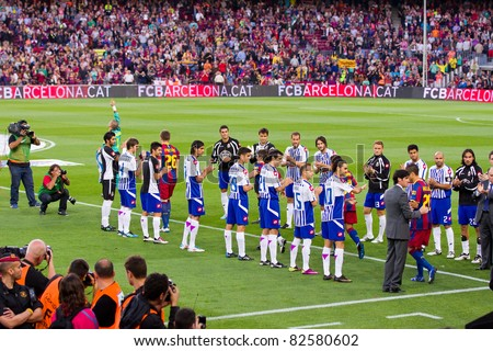 BARCELONA - MAY 15: Deportivo players do a corridor to Barcelona players during the celebration of the Spanish League Championship victory, on May 15, 2011 in Camp Nou stadium, Barcelona, Spain. - stock photo