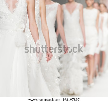 BARCELONA - MAY 06: details of models walking on the Rosa Clara bridal collection 2015 catwalk during the Barcelona Bridal Week runway on May 06, 2014 in Barcelona, Spain.  - stock photo