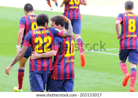 BARCELONA - MAY 03: F.C. Barcelona footballers celebrate a goal against Getafe Club de Futbol at the Camp Nou Stadium on the Spanish League on May 3, 2014 in Barcelona, Spain. - stock photo