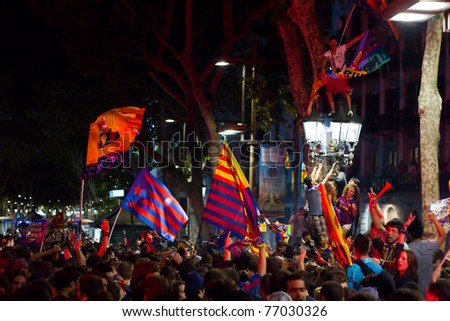 BARCELONA - MAY 11:  FC Barcelona supporters celebrate the Spanish League Championship victory in Catalunya square and Rambla street, on May 11, 2011 in Barcelona, Spain. - stock photo