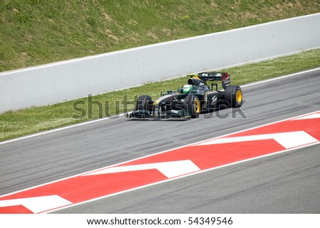 "BARCELONA- MAY 9: Heikki Kovalainen  of Lotus   in action during The Formula 1 Grand Prix at autodrome ""Catalunya Montmello"" on May 9, 2010 in Barcelona. - stock photo"