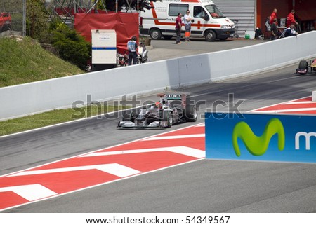 "BARCELONA- MAY 9: Michael Schumacher   of  Mercedes GP   in action during The Formula 1 Grand Prix at autodrome ""Catalunya Montmello"" on May 9, 2010 in Barcelona. Schumacher    finished 4 - stock photo"