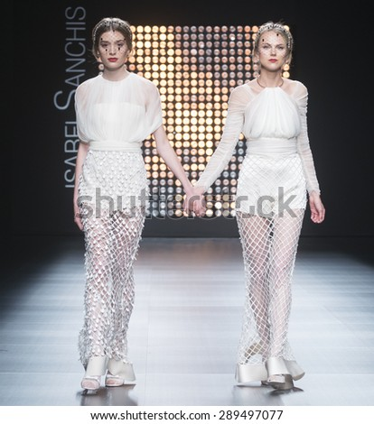 BARCELONA - MAY 06: models walking on the Isabel Sanchis bridal collection 2016 catwalk during the Barcelona Bridal Week runway on May 06, 2015 in Barcelona, Spain.   - stock photo
