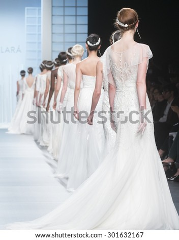 BARCELONA - MAY 05: models walking on the Rosa Clara bridal collection 2016 catwalk during the Barcelona Bridal Week runway on May 05, 2015 in Barcelona, Spain.  - stock photo