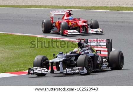 BARCELONA - MAY 13: Pastor Maldonado of Williams Renault F1 team racing at the race of Formula One Spanish Grand Prix at Catalunya circuit, on May 13, 2012 in Barcelona, Spain. He wins the race. - stock photo