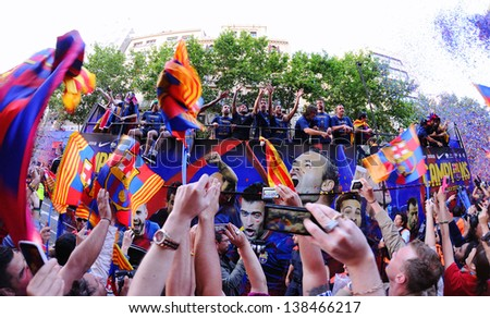 BARCELONA - MAY 13: Players of F.C Barcelona hails the champions of La Liga on May 13, 2013 in Barcelona, Spain. The league champions traversed the city to celebrate the title they won this weekend. - stock photo