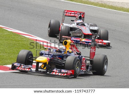 BARCELONA - MAY 13: Sebastian Vettel of Red Bull F1 team racing at the Formula One Spanish Grand Prix at Catalunya circuit, on May 13, 2012 in Barcelona, Spain. The winner was Pastor Maldonado. - stock photo