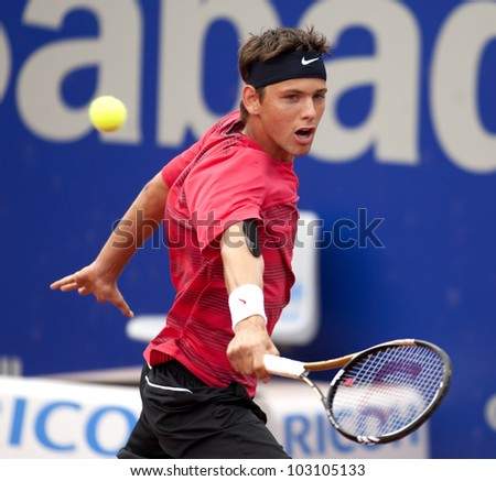 BARCELONA - MAY, 25: Serbian tennis player Filip Krajinovic in action during his match against David Ferrer of Barcelona tennis tournament Conde de Godo on April 25, 2012 in Barcelona - stock photo