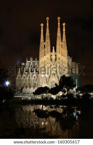 BARCELONA - MAY 10: The Basilica of La Sagrada Familia at night. Designed by Antoni Gaudi, its construction began in 1882 and is not finished yet on May 10, 2013 in Barcelona, Spain.  - stock photo