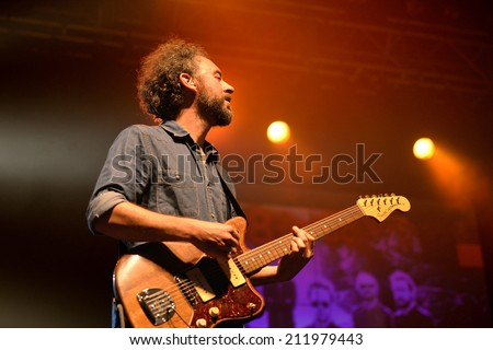 BARCELONA - MAY 16: The guitarist of Mishima (band from Catalonia) in a concert at Razzmatazz stage on May 16, 2014 in Barcelona, Spain. - stock photo