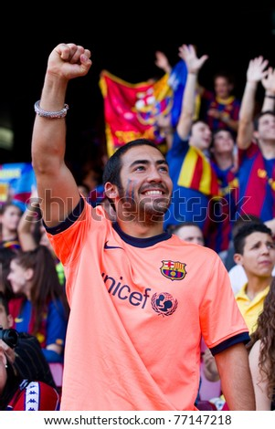BARCELONA - MAY 13: Unidentified FC Barcelona supporter celebrate the Spanish League Championship victory in Camp Nou stadium, on May 13, 2011 in Barcelona, Spain. - stock photo
