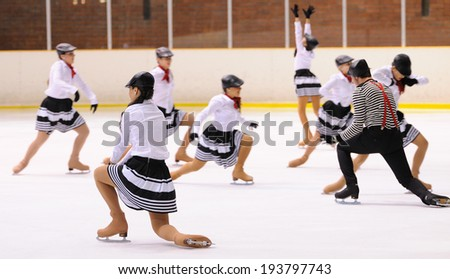 BARCELONA - MAY 03: Young team from a school of skating on ice performs at the International Cup Ciutat de Barcelona Open on May 3, 2014 in Barcelona, Spain. - stock photo