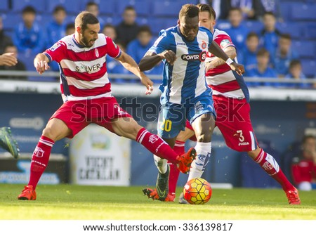 BARCELONA - NOV, 1: David Lomban(L) of Granada CF and Felipe Caicedo(R) of RCD Espanyol fight during a Spanish League match at the Power8 stadium on November 1 2015 in Barcelona Spain - stock photo