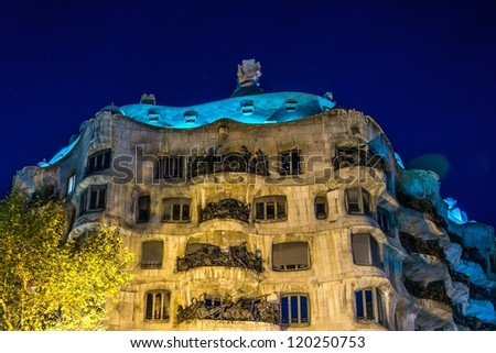 BARCELONA - NOVEMBER 24: Antonio Gaudi's famous Casa Mila, also known as La Pedrera , illuminated at night,  on November 24, 2012 in Barcelona, Spain - stock photo