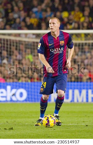 BARCELONA - NOVEMBER 1: Jeremy Mathieu of FCB in action at Spanish League match between FC Barcelona and Celta de Vigo, final score 0-1, on November 1, 2014, in Camp Nou stadium, Barcelona, Spain. - stock photo