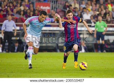 BARCELONA - NOVEMBER 1: Lionel Messi (R) of FCB in action at Spanish League match between FC Barcelona and Celta de Vigo, final score 0-1, on November 1, 2014, in Camp Nou stadium, Barcelona, Spain. - stock photo