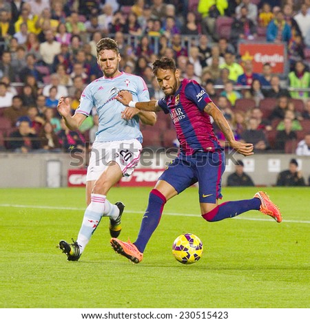 BARCELONA - NOVEMBER 1: Neymar Junior (R) in action at Spanish League match between FC Barcelona and Celta de Vigo, final score 0-1, on November 1, 2014, in Camp Nou stadium, Barcelona, Spain. - stock photo